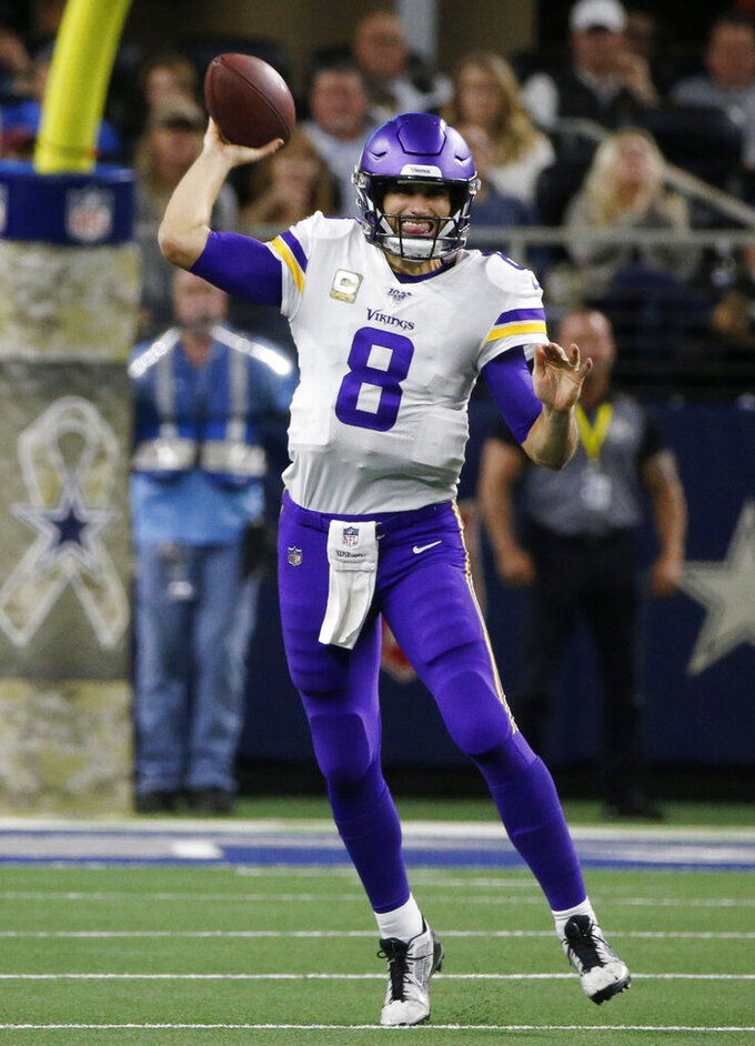 Minnesota Vikings quarterback Kirk Cousins (8) throws a pass during the second half of the team's NFL football game against the Dallas Cowboys in Arlington, Texas, Sunday, Nov. 10, 2019. (AP Photo/Michael Ainsworth)