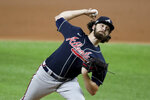 Atlanta Braves starting pitcher Ian Anderson delivers against the Los Angeles Dodgers during the first inning in Game 7 Sunday, Oct. 18, 2020, in the best-of-seven National League Championship Series in Arlington, Texas.  (Curtis Compton/Atlanta Journal-Constitution via AP)