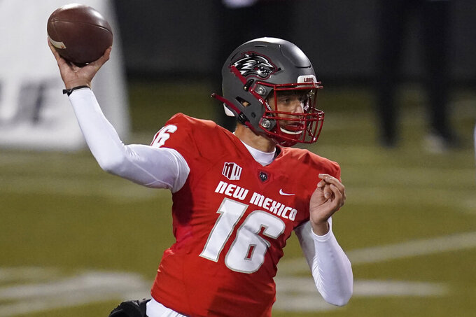New Mexico quarterback Connor Genal throws a pass against Wyoming during the first half of an NCAA college football game Saturday, Dec. 5, 2020, in Las Vegas. (AP Photo/John Locher)