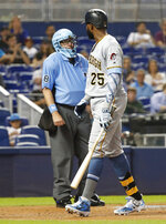 Pittsburgh Pirates' Gregory Polanco (25) argues a call with home plate umpire Gary Cederstrom after striking out during the fourth inning of a baseball game against the Miami Marlins, Sunday, June 16, 2019, in Miami. (AP Photo/Wilfredo Lee)