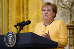 German Chancellor Angela Merkel speaks during a news conference with President Joe Biden in the East Room of the White House in Washington, Thursday, July 15, 2021. (AP Photo/Susan Walsh)