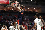 Virginia forward Jay Huff (30) dunks over Miami guard Isaiah Wong (2) during the first half of an NCAA college basketball game, Wednesday, March 4, 2020, in Coral Gables, Fla. (AP Photo/Lynne Sladky)