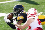 Iowa defensive back Matt Hankins breaks up a pass intended for Nebraska wide receiver Levi Falck (88) during the first half of an NCAA college football game, Friday, Nov. 27, 2020, in Iowa City, Iowa. (AP Photo/Charlie Neibergall)