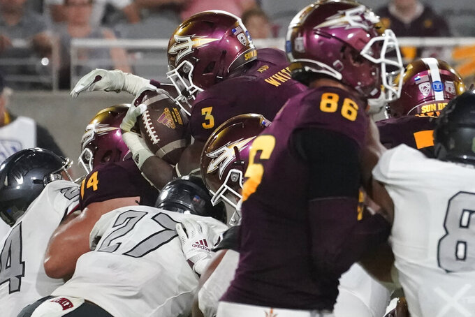 Arizona State running back Rachaad White (3) scores a touchdown against UNLV during the second half of an NCAA college football game, Saturday, Sept. 11, 2021, in Tempe, Ariz. (AP Photo/Matt York)