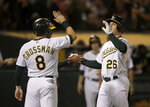 Oakland Athletics' Matt Chapman, right, celebrates with Robbie Grossman (8) after hitting a three-run home run off Los Angeles Angels' Jaime Barria during the third inning of a baseball game Tuesday, Sept. 3, 2019, in Oakland, Calif. (AP Photo/Ben Margot)