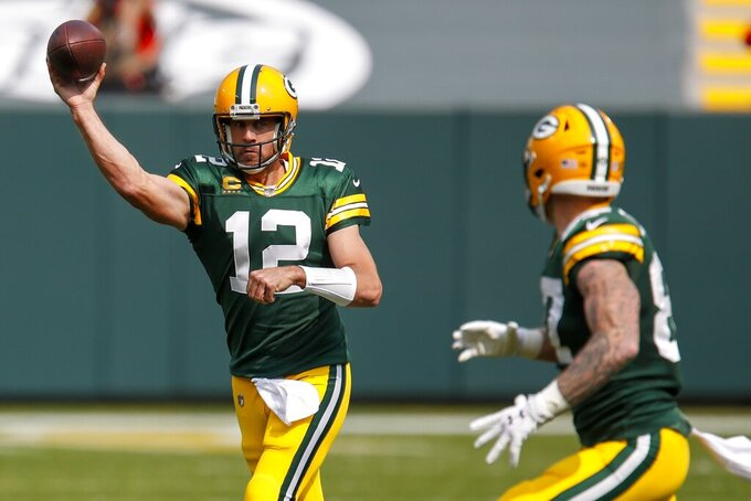 Green Bay Packers' Aaron Rodgers throws to Jace Sternberger during the first half of an NFL football game against the Detroit Lions Sunday, Sept. 20, 2020, in Green Bay, Wis. (AP Photo/Matt Ludtke)