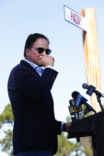 Former New York Mets catcher Mike Piazza chokes up as he talks about his father as he speaks during a ceremony after the unveiling of newly named Piazza Dr., in front of the Mets spring training facility, Thursday, Jan. 16, 2020, in Port St. Lucie, Fla. (AP Photo/Wilfredo Lee)