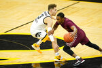 North Carolina Central guard Mike Melvin drives past Iowa guard Jordan Bohannon, left, during the first half of an NCAA college basketball game, Wednesday, Nov. 25, 2020, in Iowa City, Iowa. (AP Photo/Charlie Neibergall)