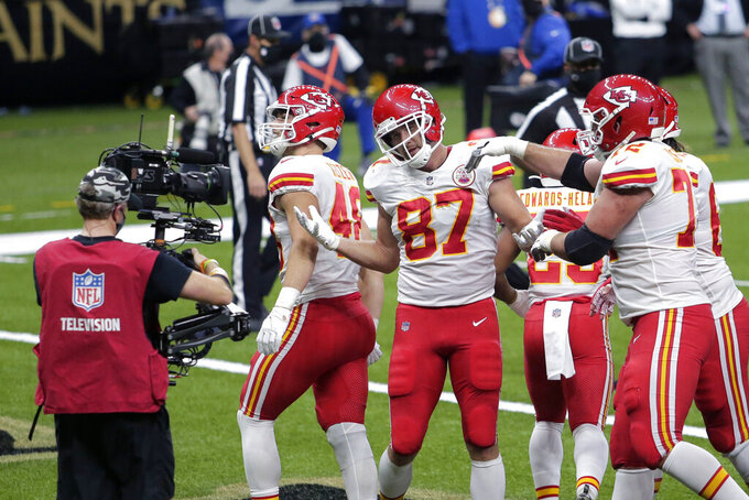 Kansas City Chiefs tight end Travis Kelce (87) celebrates his touchdown reception in the first half of an NFL football game against the New Orleans Saints in New Orleans, Sunday, Dec. 20, 2020. (AP Photo/Brett Duke)