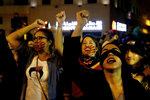 Protesters chant slogans during a demonstration to protest sexual harassment and bullying and demanding rights, in front of the government house in downtown Beirut, Lebanon, Saturday, Dec. 7, 2019. Scores of women marched through the streets to protest sexual harassment and bullying and demanding rights including the passing of citizenship to children of Lebanese women married to foreigners. (AP Photo/Bilal Hussein)