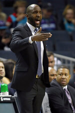 Atlanta Hawks' head coach Lloyd Pierce makes a call from the bench against the Charlotte Hornets during the first half of an NBA basketball game in Charlotte, N.C., Sunday, Dec. 8, 2019. (AP Photo/Bob Leverone)
