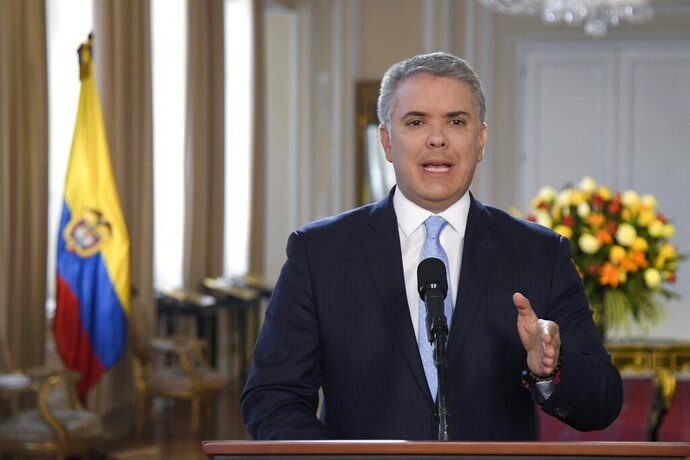 In this photo released by the Colombia's Presidential Press Office, President Ivan Duque gives a statement at Palacio de Narino in Bogota, Colombia, Thursday, Aug. 29, 2019. Duque is lashing out against Venezuelan President Nicolas Maduro for allegedly providing safe haven to a cadre of demobilized Revolutionary Armed Forces of Colombia rebel leaders who announced they are rearming. (Efrain Herrera/Colombia's Presidential Press Office via AP)