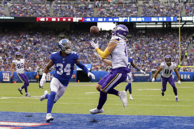 Minnesota Vikings wide receiver Adam Thielen (19) makes a touchdown catch against New York Giants defensive back Grant Haley (34) during the second quarter of an NFL football game, Sunday, Oct. 6, 2019, in East Rutherford, N.J. (AP Photo/Adam Hunger)