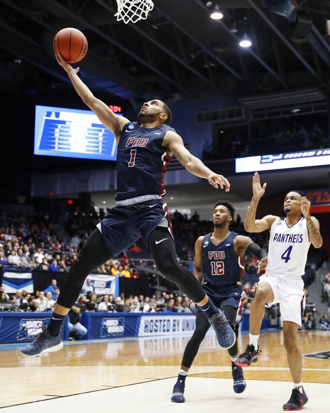 Fairleigh Dickinson's Darnell Edge (1) shoots as Prairie View A&M's Antione Lister (4) looks on during the first half of a First Four game of the NCAA college basketball tournament, Tuesday, March 19, 2019, in Dayton, Ohio. (AP Photo/John Minchillo)