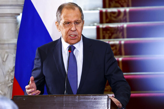 In this photo released by Russian Foreign Ministry Press Service, Russia's Foreign Minister Sergey Lavrov gestures during his and Egyptian Foreign Minister Sameh Shukry joint news conference following their talks in Cairo, Egypt, Monday, April 12, 2021. (Russian Foreign Ministry Press Service via AP)