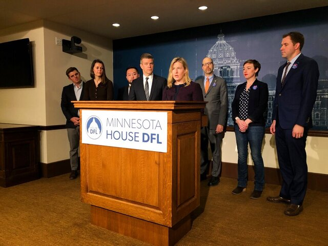 Minnesota House Democratic leaders line up for a news conference Thursday, Feb. 6, 2020, at the state Capitol in St. Paul, Minnesota. Pictured left to right are Rep. Michael Howard, of Richfield; House Majority Whip Liz Olson, of Duluth; Assistant Majority Leader Fue Lee, of Minneapolis; Majority Leader Ryan Winkler, of Golden Valley; Speaker Melissa Hortman, of Brooklyn Park; Rep. David Pinto, of St. Paul; Rep. Carlie Kotyza-Witthuhn, of Eden Prairie; and Assistant Majority Leader Jamie Long, of Minneapolis. (AP Photo/Steve Karnowski)