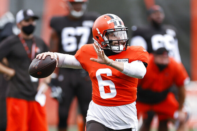 FILE - Cleveland Browns quarterback Baker Mayfield throws a pass during practice at the NFL football team's training facility Monday, Aug. 17, 2020, in Berea, Ohio. This is a huge season for Mayfield, who stumbled in his second year and finished near the league's bottom in numerous statistical categories. The Browns play the Cleveland Browns on Sunday, Sept. 13. (AP Photo/Ron Schwane, File)