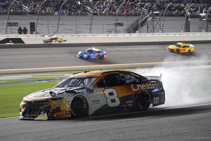 Tyler Reddick (8) heads down pit road after he was in a crash during a NASCAR Cup Series auto race at Daytona International Speedway, Saturday, Aug. 28, 2021, in Daytona Beach, Fla. (AP Photo/Phelan M. Ebenhack)