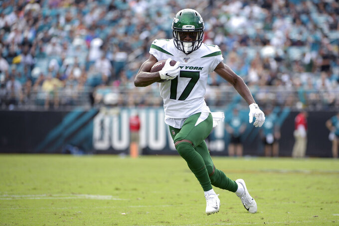 FILE - In this Oct. 27, 2019, file photo, New York Jets wide receiver Vyncint Smith (17) runs after catching a pass during the second half of an NFL football game against the Jacksonville Jaguars in Jacksonville, Fla. Vyncint Smith had surgery Tuesday, Aug. 18, 2020, to repair a core muscle injury and could be sidelined up to two months.  Adam Gase confirmed the procedure and prognosis, saying Smith will likely miss 5-to-8 weeks. (AP Photo/Phelan M. Ebenhack, File)