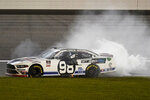 Chase Briscoe (98) celebrates after winning a NASCAR Xfinity Series auto race at Kansas Speedway in Kansas City, Kan., Saturday, Oct. 17, 2020. (AP Photo/Orlin Wagner)