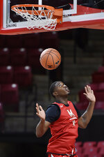 Maryland NCAA college basketball player Darryl Morsell practices during Media Day, Tuesday, Oct. 15, 2019, in College Park, Md. (AP Photo/Gail Burton)