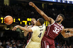 Vanderbilt guard Jordan Wright (4) passes the ball away from Texas A&M forward Josh Nebo (32) in the first half of an NCAA college basketball game Saturday, Jan. 11, 2020, in Nashville, Tenn. (AP Photo/Mark Humphrey)