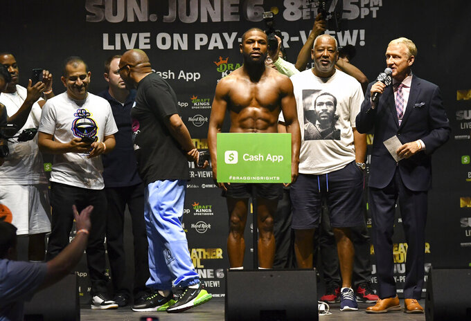 Floyd Mayweather poses for photographers during a weigh-in Saturday, June 5, 2021, in Hollywood, Fla. Mayweather is scheduled to fight Logan Paul in an exhibition boxing match at Hard Rock Stadium in Miami Gardens, Fla., Sunday. (AP Photo/Jim Rassol)