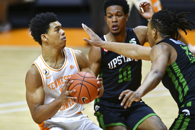 Tennessee's Jaden Springer, left, is guarded by South Carolina-Upstate's Tommy Bruner (10) and Jatayveous Watson, right, during an NCAA college basketball game Wednesday, Dec. 23, 2020, in Knoxville, Tenn. (Saul Young/Knoxville News Sentinel via AP, Pool)