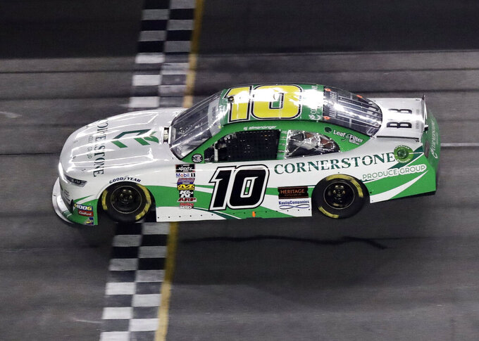 A J Allmendinger (10) wins the second stage of a NASCAR Xfinity Series auto race at Daytona International Speedway, Friday, July 5, 2019, in Daytona Beach, Fla. (AP Photo/John Raoux)