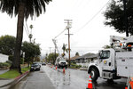 Edison crews work to restore power lines along West Figueroa Street in  Santa Barbara, Calif., Wednesday, March 6, 2019.  A downpour rolled into California with spectacular lightning and thunderclaps Tuesday night in one of the most electric storm systems of the winter. The storm was the latest atmospheric river to flow into California this winter. The National Weather Service reported