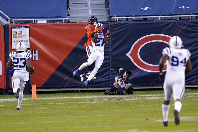 Indianapolis Colts' Xavier Rhodes (27) breaks up a pass intended for Chicago Bears' Allen Robinson (12) during the second half of an NFL football game, Sunday, Oct. 4, 2020, in Chicago. (AP Photo/Charles Rex Arbogast)