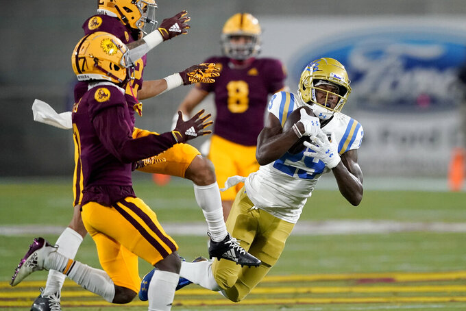 UCLA wide receiver Delon Hurt (29) pulls in a first down catch as Arizona State defensive back DeAndre Pierce, left, defends during the first half of an NCAA college football game, Saturday, Dec. 5, 2020, in Tempe, Ariz. (AP Photo/Matt York)