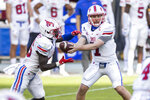 SMU quarterback Shane Buechele (7) hands off to running back Ulysses Bentley IV (26) during the second half of an NCAA college football game against Temple, Saturday, Nov. 7, 2020, in Philadelphia. SMU won 47-23. (AP Photo/Laurence Kesterson)