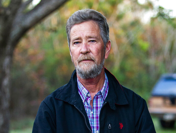 FILE - In this Dec. 5, 2018 file photo, Leslie McCrae Dowless Jr. poses for a portrait outside of his home in Bladenboro, N.C. The Republican in the nation's last undecided congressional election said Monday, Feb. 11, 2019 he recruited a political operative now at the center of a ballot fraud investigation because he produced election results in his rural North Carolina county and other Republicans vouched for him. Mark Harris said he didn't know before November's election that state elections board investigators found evidence that operative Dowless Jr. may have illegally handled ballots in 2016. (Travis Long/The News & Observer via AP, File)
