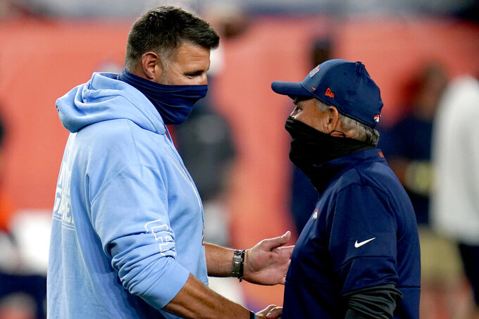 Tennessee Titans head coach Mike Vrabel, left, greets Denver Broncos head coach Vic Fangio prior to an NFL football game, Monday, Sept. 14, 2020, in Denver. (AP Photo/David Zalubowski)