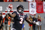 Emeka Emezie (3) hauls in a long pass against Ball State during the first half of an NCAA college football game in Raleigh, N.C., Saturday, Sept. 21, 2019. (AP Photo/Karl B DeBlaker)