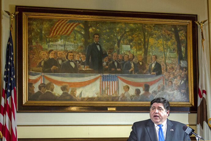 FILE - In this May 22, 2020 file photo, Illinois Gov. JB Pritzker answers questions from the media, from his office at the Illinois State Capitol, in Springfield, Ill., in front of a painting painting depicting a political debate in Charleston, Ill., on Sept. 18, 1858 between Stephen A. Douglas and Abraham Lincoln. (Justin L. Fowler/The State Journal-Register via AP, Pool File)/The State Journal-Register via AP)