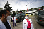 Dr. Marta Beatriz Sanchez, who returned to work Tuesday after recovering from a coronavirus infection, stands outside the COVID-19 hospital in Military Camp 1 after an earthquake was felt, in Naucalpan, Mexico State, part of the Mexico City metropolitan area, Tuesday, June 23, 2020. On the grounds of the military base, a barracks has been converted into a 100-bed hospital treating recovering and moderately ill COVID-19 patients who come from both the military and civilian populations. (AP Photo/Rebecca Blackwell)