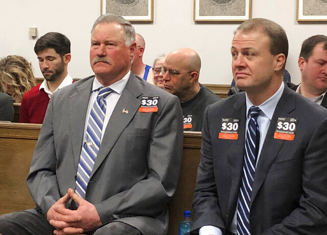 Franklin County Commissioner Clint Didier, left, and initiative promoter Tim Eyman, right, listen to arguments during a hearing in King County Superior Court, Friday, Feb. 7, 2020, in Seattle, over the constitutionality of Eyman's Initiative 976 to reduce car licensing fees. (AP Photo/Gene Johnson)