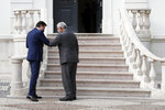 Italy's Prime Minister Giuseppe Conte and Portugal's Prime Minister Antonio Costa, right, greet each other before their meeting at the Sao Bento palace in Lisbon, Tuesday, July 7, 2020. Southern European countries are mounting a show of strength as negotiations over how much money they get from the EU, and in what form, comes to a crunch. (AP Photo/Armando Franca)