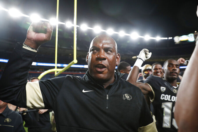 Colorado head coach Mel Tucker joins his players in singing the school song after defeating intrastate rival Colorado State in an NCAA college football game Friday, Aug. 30, 2019, in Denver. Colorado won 52-31. (AP Photo/David Zalubowski)