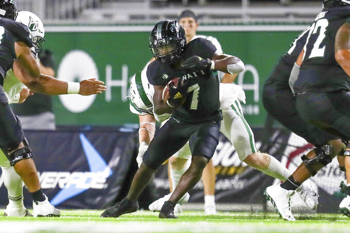Hawaii running back Calvin Turner Jr. (7) looks for running room after making a catch during the first half of an NCAA college football game against Portland State, Saturday, Sept. 4, 2021, in Honolulu. (AP Photo/Darryl Oumi)