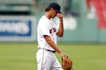 Boston Red Sox's Kyle Hart walks off the field after being taken out during the third inning of a baseball game against the Tampa Bay Rays, Thursday, Aug. 13, 2020, in Boston. (AP Photo/Michael Dwyer)