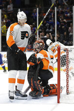 iPhiladelphia Flyers' Samuel Morin (55) and goaltender Carter Hart (79) react after New York Islanders' Mathew Barzal scored a goal during the second period of an NHL hockey game Sunday, Oct. 27, 2019, in Uniondale, N.Y. (AP Photo/Frank Franklin II)