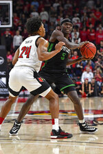 USC Upstate guard Bryson Mozone (5) looks for help from the defensive pressure of Louisville forward Dwayne Sutton (24) during the first half of an NCAA college basketball game in Louisville, Ky., Wednesday, Nov. 20, 2019. (AP Photo/Timothy D. Easley)