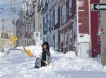 A resident digs a path from his house in St. John's Newfoundland on Saturday, Jan.  18, 2020. The state of emergency ordered by the City of St. John's is still in place, leaving businesses closed and vehicles off the roads in the aftermath of the major winter storm that hit the Newfoundland and Labrador capital.  (Andrew Vaughan/The Canadian Press via AP)