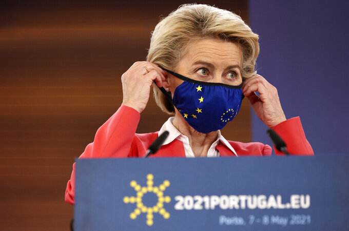 European Commission President Ursula von der Leyen puts on her protective face mask at the conclusion of a media conference at an EU summit in Porto, Portugal, Saturday, May 8, 2021. On Saturday, EU leaders held an online summit with India's Prime Minister Narendra Modi, covering trade, climate change and help with India's COVID-19 surge. (AP Photo/Luis Vieira)