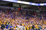 The Pittsburgh student section tosses Los Angeles Lakers colored purple and gold confetti after Pitt scored its first basket in honor of former basketball great Kobe Bryant, who was killed with eight others in a helicopter crash, during the first half of an NCAA college basketball game, Sunday, Feb. 2, 2020, in Pittsburgh. (AP Photo/Keith Srakocic)