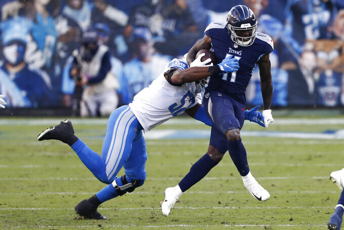 Tennessee Titans wide receiver A.J. Brown is tackled by Detroit Lions outside linebacker Christian Jones during the second half of an NFL football game Sunday, Dec. 20, 2020, in Nashville, Tenn. (AP Photo/Wade Payne)