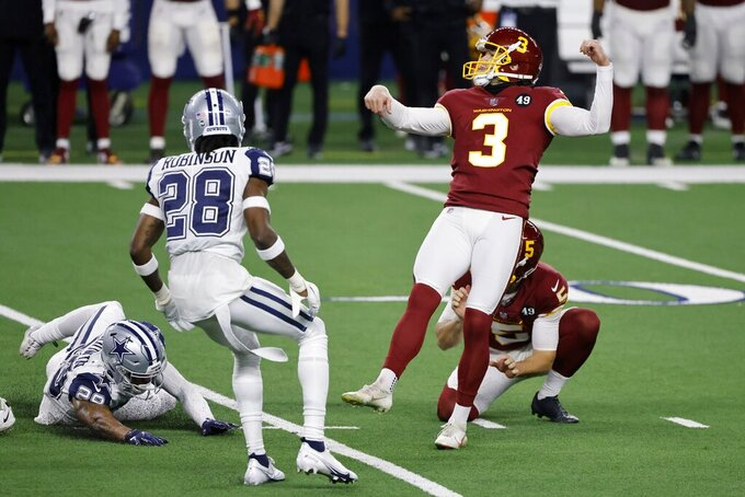 Dallas Cowboys' C.J. Goodwin (29) and Rashard Robinson (28) pressure as Washington Football Team's Dustin Hopkins (3) watches his field goal kick go through the uprights in the second half of an NFL football game in Arlington, Texas, Thursday, Nov. 26, 2020. (AP Photo/Ron Jenkins)